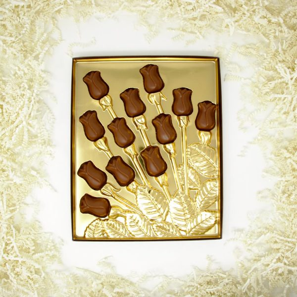 a dozen chocolate roses in a gold gift box